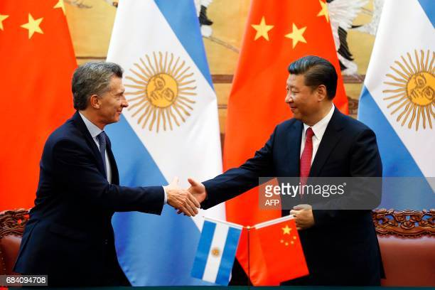 Chinese President Xi Jinping shakes hands with Argentina's President Mauricio Macri during a signing ceremony at the Great Hall of the People in...