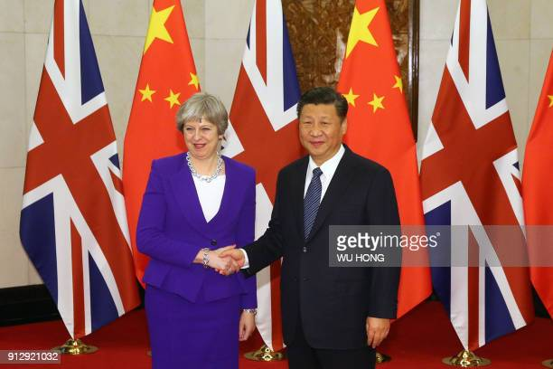 Chinese President Xi Jinping shakes hands with Britain's Prime Minister Theresa May ahead of their meeting at the Diaoyutai State Guesthouse in...