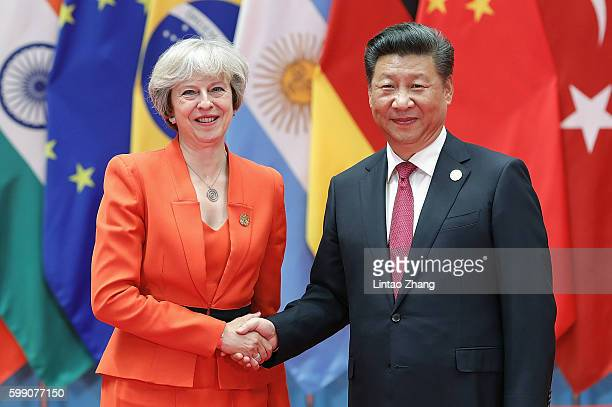 Chinese President Xi Jinping shakes hands with British Prime Minister Theresa May to the G20 Summit on September 4 2016 in Hangzhou China World...