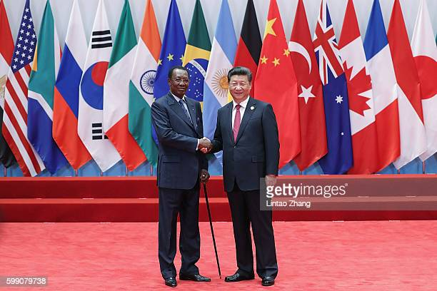 Chinese President Xi Jinping shakes hands with Chad President Idriss Deby Itno to the G20 Summit on September 4 2016 in Hangzhou China World leaders...