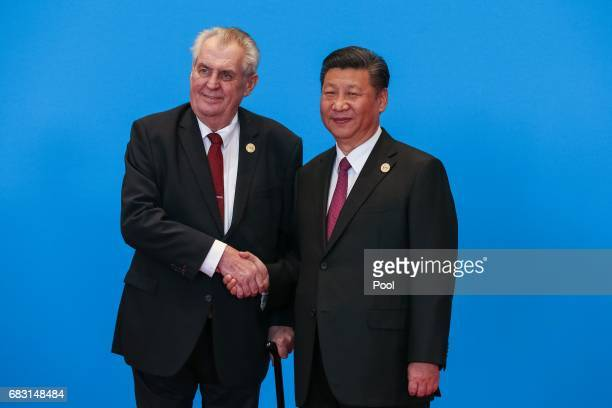 Chinese President Xi Jinping shakes hands with Czech President Milos Zeman as they attend the welcome ceremony at Yanqi Lake during the Belt and Road...