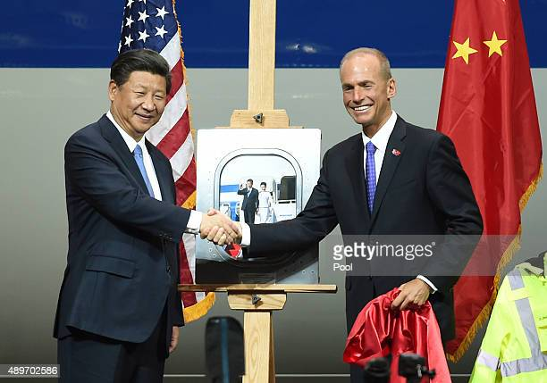 Chinese President Xi Jinping shakes hands with Dennis Muilenburg President and CEO of the Boeing Company after Xi's tour of the Boeing assembly line...