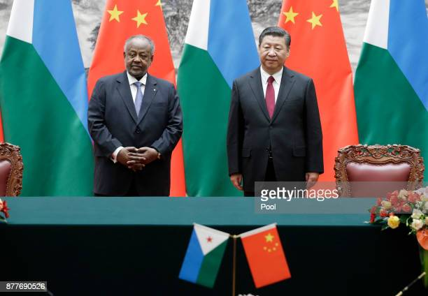 Chinese President Xi Jinping shakes hands with Djibouti's President Ismail Omar Guelleh during a signing ceremony at the Great Hall of the People on...
