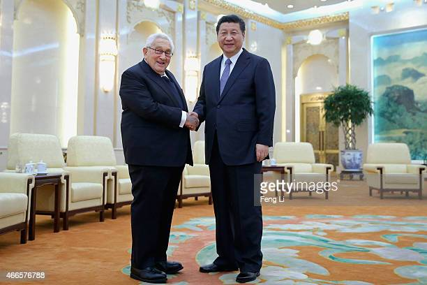 Chinese President Xi Jinping shakes hands with Former United States Secretary of State Henry Kissinger at the Great Hall of the People on March 17...
