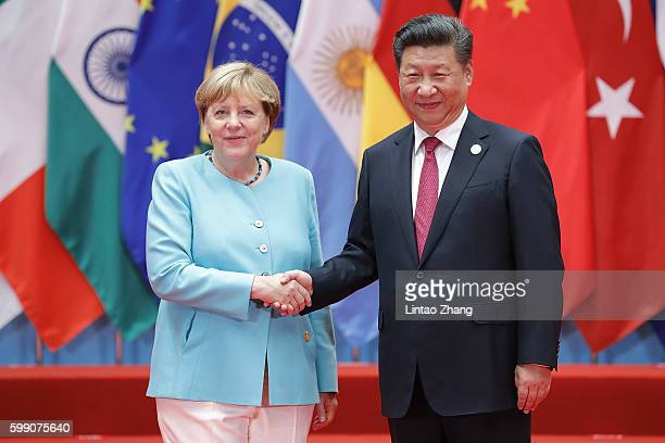 Chinese President Xi Jinping shakes hands with German Chancellor Angela Merkel to the G20 Summit on September 4 2016 in Hangzhou China World leaders...