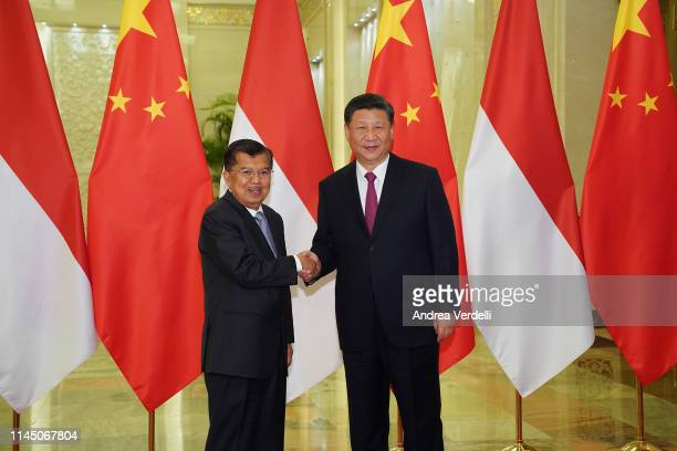 Chinese President Xi Jinping shakes hands with Indonesia Vice President Jusuf Kalla before the bilateral meeting of the Second Belt and Road Forum at...