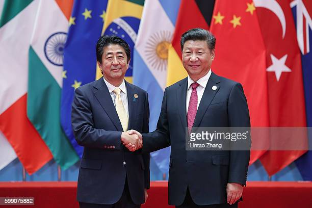 Chinese President Xi Jinping shakes hands with Japanese Prime Minister Shinzo Abe to the G20 Summit on September 4 2016 in Hangzhou China World...