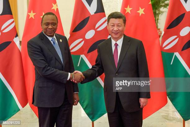 Chinese President Xi Jinping shakes hands with Kenyan President Uhuru Kenyatta prior to their bilateral meeting during the Belt and Road Forum for...