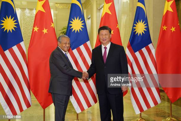 Chinese President Xi Jinping shakes hands with Malaysian Prime Minister Mahathir Mohamad before the bilateral meeting of the Second Belt and Road...