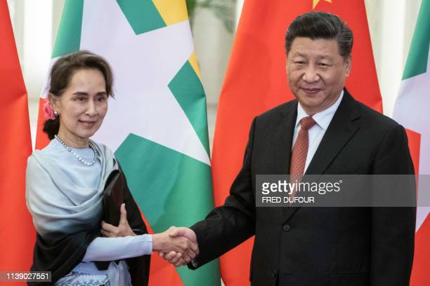 Chinese President Xi Jinping shakes hands with Myanmar State Counsellor Aung San Suu Kyi at the Great Hall of the People in Beijing on April 24 2019