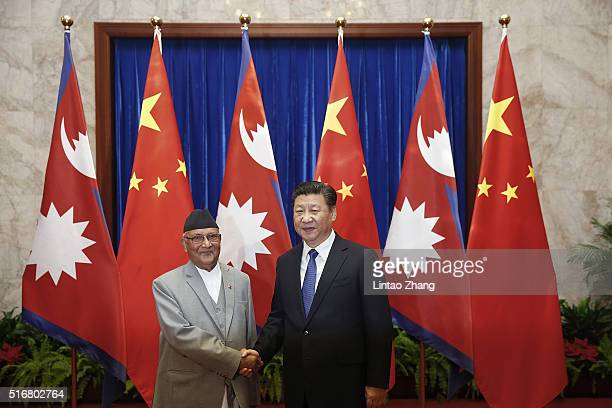 Chinese President Xi Jinping shakes hands with Nepal Prime Minister Khadga Prasad Sharma Oli inside the Great Hall of the People on March 21 2016 in...
