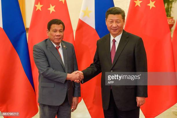 Chinese President Xi Jinping shakes hands with Philippines President Rodrigo Duterte prior to their bilateral meeting during the Belt and Road Forum...