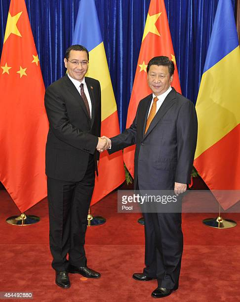Chinese President Xi Jinping shakes hands with Romanian Prime Minister Victor Ponta before their meeting at the Great Hall of the People on September...