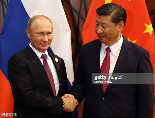 Chinese President Xi Jinping shakes hands with Russian President Vladimir Putin during their bilateral meeting at the AsiaPacific Economic...
