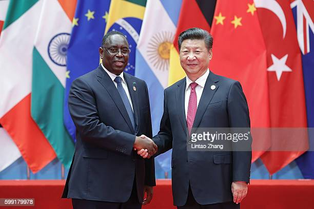 Chinese President Xi Jinping shakes hands with Senegalese President Macky Sall to the G20 Summit at the Hangzhou International Expo Center on...