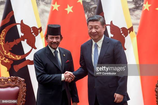 Chinese President Xi Jinping shakes hands with Sultan of Brunei Hassanal Bolkiah after a signing ceremony following their bilateral meeting at the...