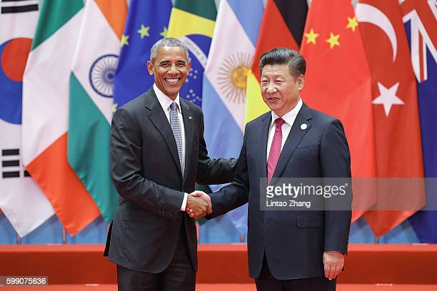 Chinese President Xi Jinping shakes hands with US President Barack Obama to the G20 Summit on September 4 2016 in Hangzhou China World leaders are...
