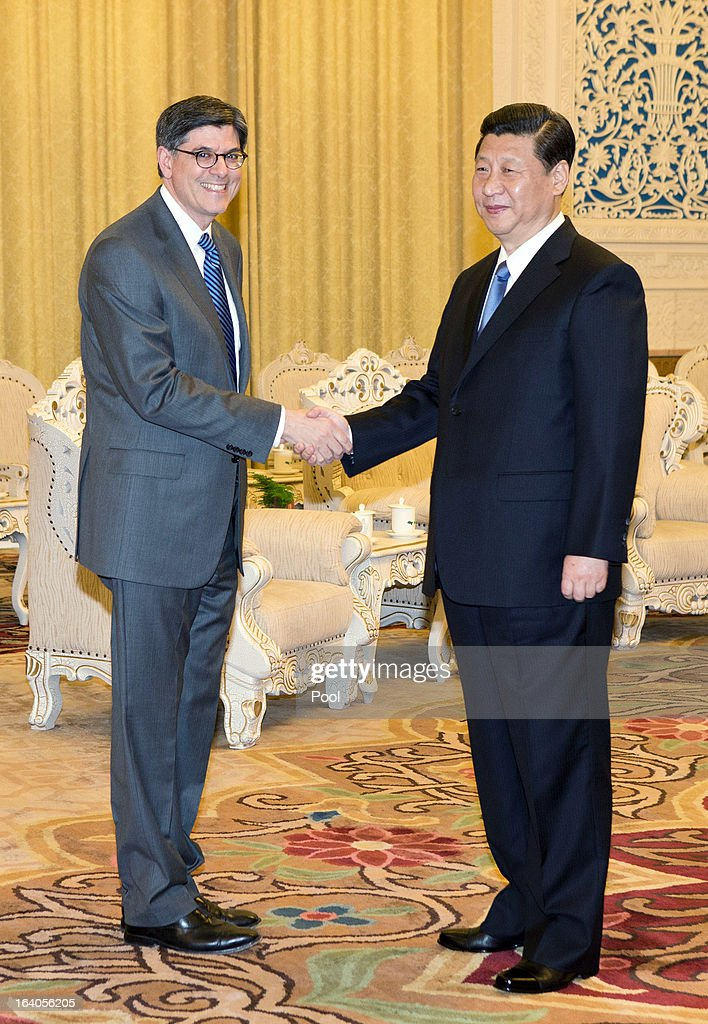 Chinese President Xi Jinping (R) shakes hands with U.S. Secretary of Treasury Jacob Lew during his visit to the Great Hall of the People on March 19, 2013 in Beijing, China. Chinese leader Xi Jinping spoke of wanting strong ties with the U.S. after holding talks with the US Treasury secretary Jacob Lew today in his first meeting with a foreign official since being appointed as president.