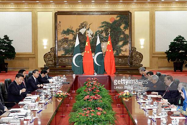 Chinese President Xi Jinping shankes hands with Pakistan President Mamnoon Hussain at The Great Hall Of The People on September 2 2015 in Beijing...