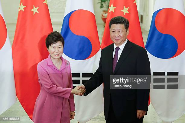 Chinese President Xi Jinping shankes hands with South Korean President Park Geun-hye at The Great Hall Of The People on September 2, 2015 in Beijing,...