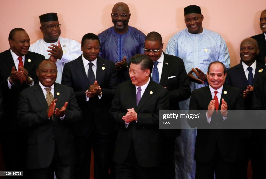Chinese President Xi Jinping (front C), South African President Cyril Ramaphosa (front 3-L), Egyptian President Abdel Fattah al-Sisi(front L), Kenyas President Uhuru Kenyatta (2nd row L), Togos President Faure Gnassingbé(2nd row 2-L), Malawi's President Arthur Peter Mutharika (2nd row C), Guinea-Bissau's President Jose Mario Vaz (2nd row R), Sierra Leone President Julius Maada Bio (last row L), Liberian President George Weah (last row C) and other African leadersclap during a group photo session during the Forum on China-Africa Cooperation (FOCAC) 2018 Beijing Summit on September 3, 2018 in Beijing, China.