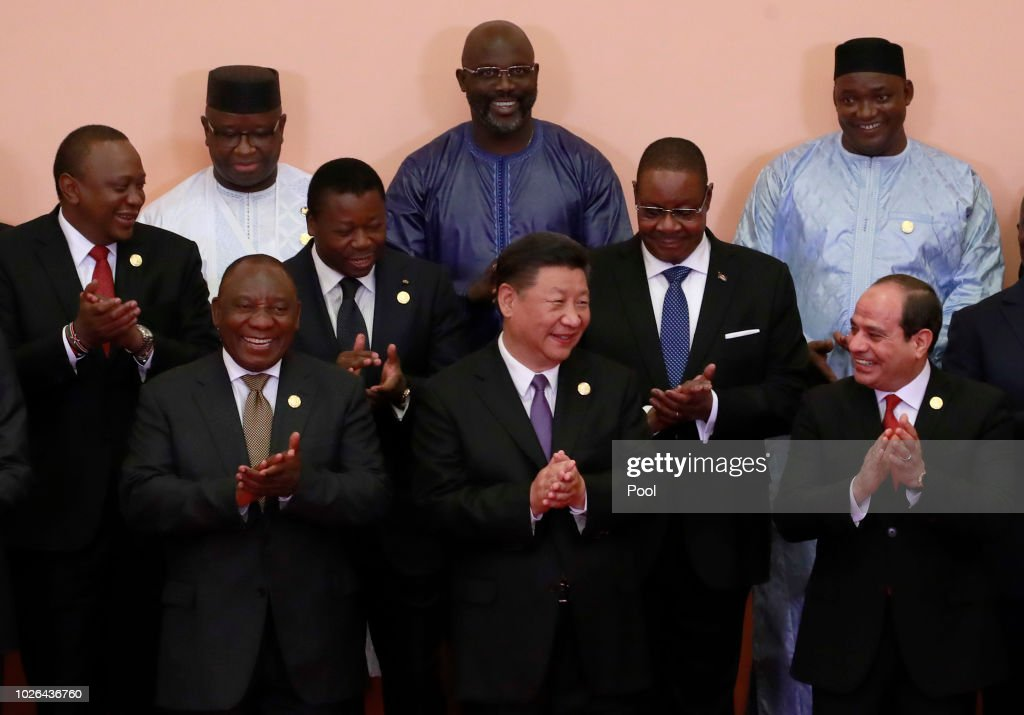 Chinese President Xi Jinping (front C), South African President Cyril Ramaphosa (front 3-L), Egyptian President Abdel Fattah al-Sisi(front L), Kenyas President Uhuru Kenyatta (2nd row L), Togos President Faure Gnassingbé(2nd row C), Malawi's President Arthur Peter Mutharika (2nd row R), Sierra Leone President Julius Maada Bio (last row L), Liberian President George Weah (last row C) and other African leaders clap during a group photo session during the Forum on China-Africa Cooperation (FOCAC) 2018 Beijing Summit on September 3, 2018 in Beijing, China.