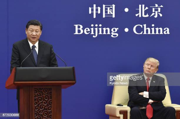 Chinese President Xi Jinping speaks at a joint press conference with US President Donald Trump following their meeting in Beijing on Nov 9 2017 The...