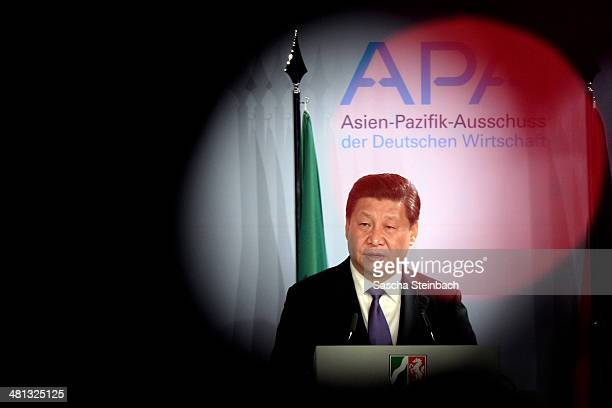 Chinese President Xi Jinping speaks at a reception in his honour on March 29 2014 in Dusseldorf Germany President Xi Jinping is visiting the western...