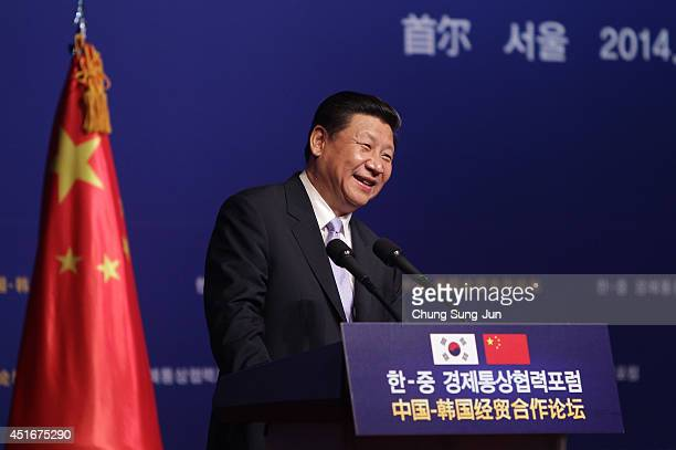Chinese President Xi Jinping speaks during a KoreaChina Investment Forum at Shilla Hotel on July 4 2014 in Seoul South Korea President Xi Jinping is...