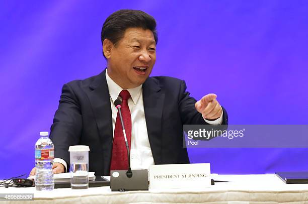 Chinese President Xi Jinping speaks during a meeting with five United States governors to discuss clean technology and economic development September...