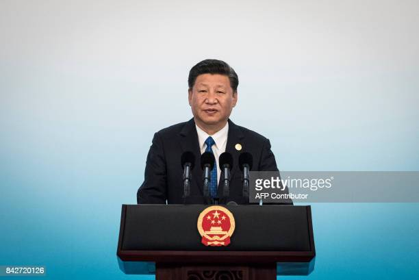Chinese President Xi Jinping speaks during a press conference at the BRICS Summit in Xiamen Fujian province on September 5 2017 Xi opened the annual...