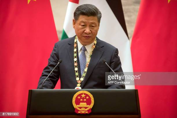 Chinese President Xi Jinping speaks during a signing ceremony at the Great Hall of the People in Beijing on July 18 2017 Abbas is on an official...