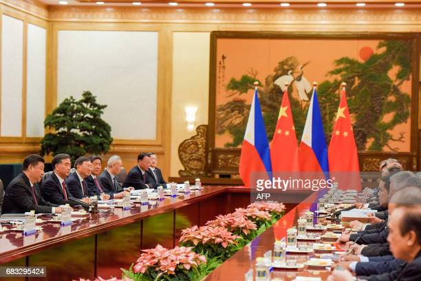 Chinese President Xi Jinping speaks during his bilateral meeting with Philippines President Rodrigo Duterte during the Belt and Road Forum for...