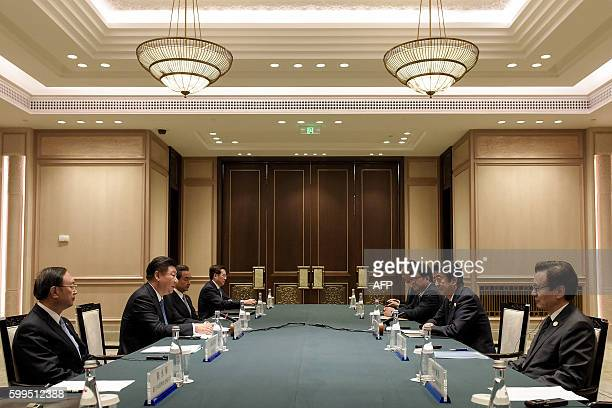 Chinese President Xi Jinping speaks to the Japanese delegation led by Japanese Prime Minister Shinzo Abe during their meeting at the West Lake State...