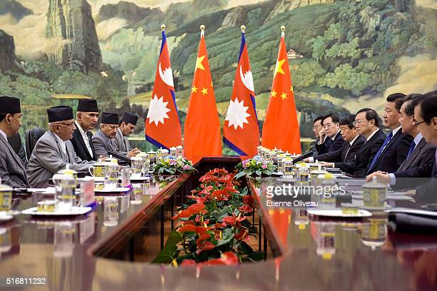 Chinese President Xi Jinping speaks with Nepal Prime Minister Khadga Prasad Sharma Oli during a conference inside the Great Hall of the People on...