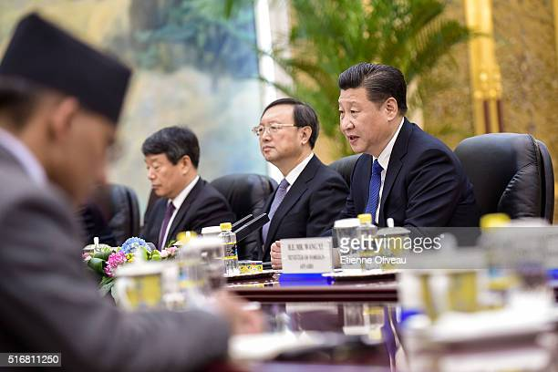Chinese President Xi Jinping speaks with Nepal Prime Minister Khadga Prasad Sharma Oli during a conference with in the Great Hall of the People on...