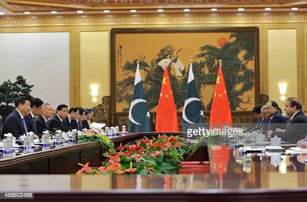 Chinese President Xi Jinping speaks with Pakistan's Prime Minister Nawaz Sharif during a meeting at the Great Hall of the People November 8 2014 in...