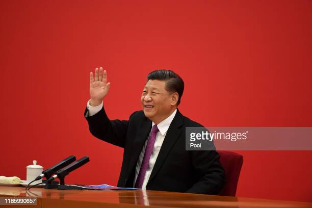Chinese President Xi Jinping speaks with Russian President Vladimir Putin via a video link, from the Great Hall of the People on December 2, 2019 in...