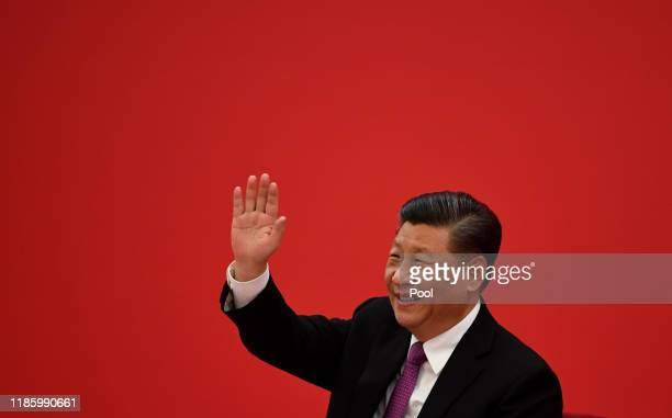 Chinese President Xi Jinping speaks with Russian President Vladimir Putin via a video link from the Great Hall of the People on December 2 2019 in...