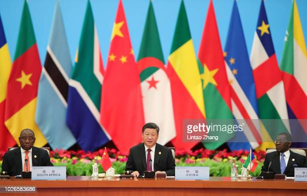 Chinese President Xi Jinping speaks with South African President Cyril Ramaphosa during the 2018 Beijing Summit Of The Forum On China-Africa...
