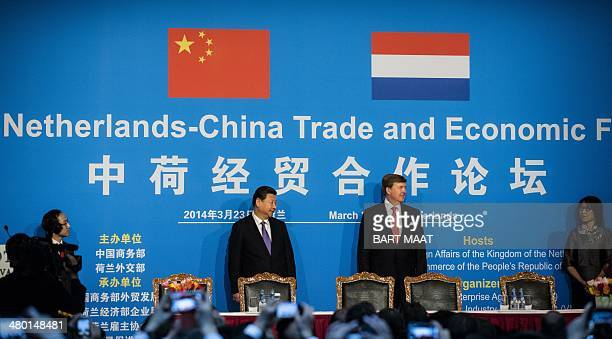 Chinese President Xi Jinping stands next to Dutch King Willem-Alexander during the opening of the Sino-Dutch Economic Forum in Noordwijk, the...