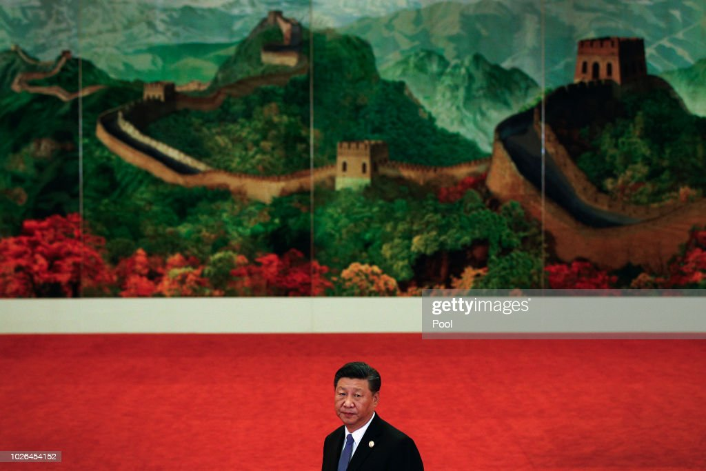 Chinese President Xi Jinping stands watch in front of the Great Wall's painting as he arrives for a welcome ceremony for the Forum on China-Africa Cooperation held at the Great Hall of the People on September 3, 2018 in Beijing, China.