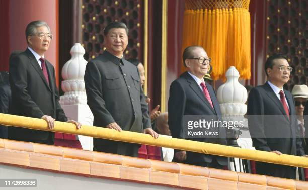 Chinese President Xi Jinping stands with former presidents Hu Jintao and Jiang Zemin during a ceremony in Beijing marking the 70th anniversary of the...
