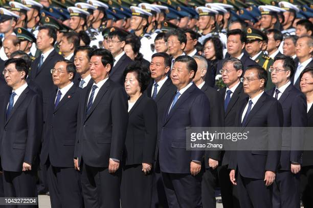 Chinese President Xi Jinping stands with other leaders during a ceremony at Tiananmen Square, on the eve of National Day on September 30, 2018 in...