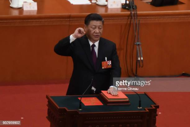 Chinese President Xi Jinping swears under oath after being elected for a second fiveyear term during the 5th plenary session of the first session of...