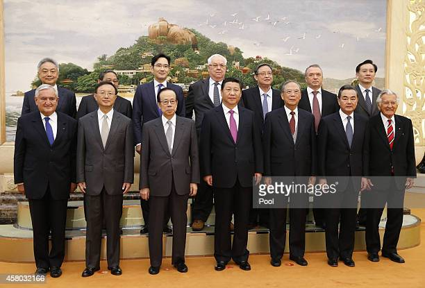 Chinese President Xi Jinping takes a photos with members of Board of Directors of the Boao Asia Forum at the Great Hall of the People on October 29,...