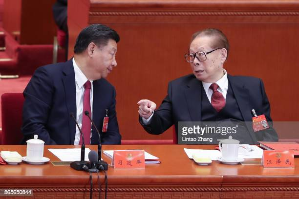 Chinese President Xi Jinping talk with China's former president Jiang Zemin during the closing of the 19th Communist Party Congress at the Great Hall...