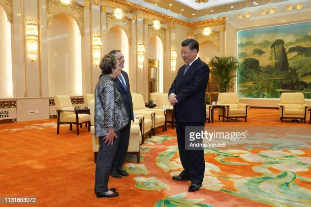 Chinese President Xi Jinping talks to Harvard University President Lawrence Bacow and his wife Adele Fleet Bacow at The Great Hall Of The People on...