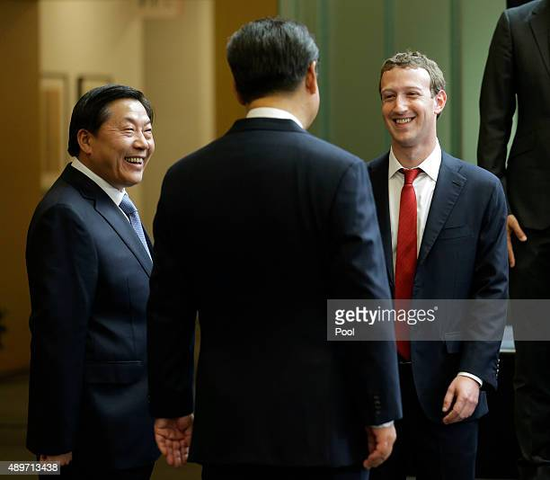 Chinese President Xi Jinping talks with Facebook Chief Executive Mark Zuckerberg as Lu Wei China's Internet czar looks on during a gathering of CEOs...