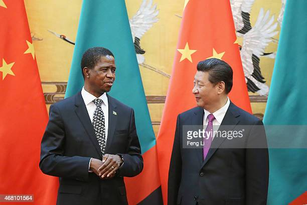 Chinese President Xi Jinping talks with Zambia's President Edgar Chagwa Lungu during a signing ceremony at the Great Hall of the People on March 30...